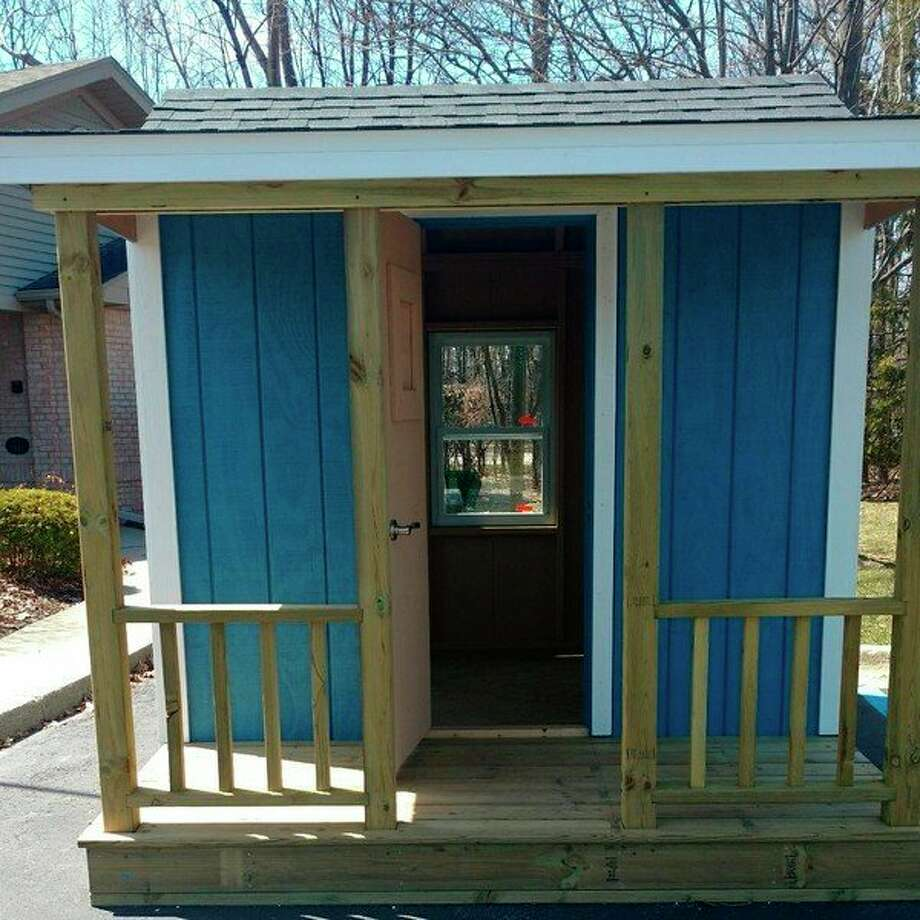 Two handcrafted playhouses built by students will help raise money for building trades programs in Saginaw County during the Home Builders Association of Saginaw Parade of Homes, which starts Saturday. (Photo provided)