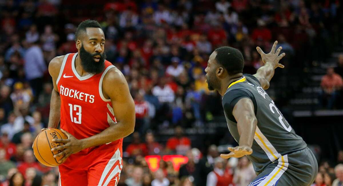 HOUSTON, TX - JANUARY 20: James Harden #13 of the Houston Rockets is guarded by Draymond Green #23 of the Golden State Warriors at Toyota Center on January 20, 2018 in Houston, Texas. NOTE TO USER: User expressly acknowledges and agrees that, by downloading and or using this photograph, User is consenting to the terms and conditions of the Getty Images License Agreement. (Photo by Bob Levey/Getty Images)