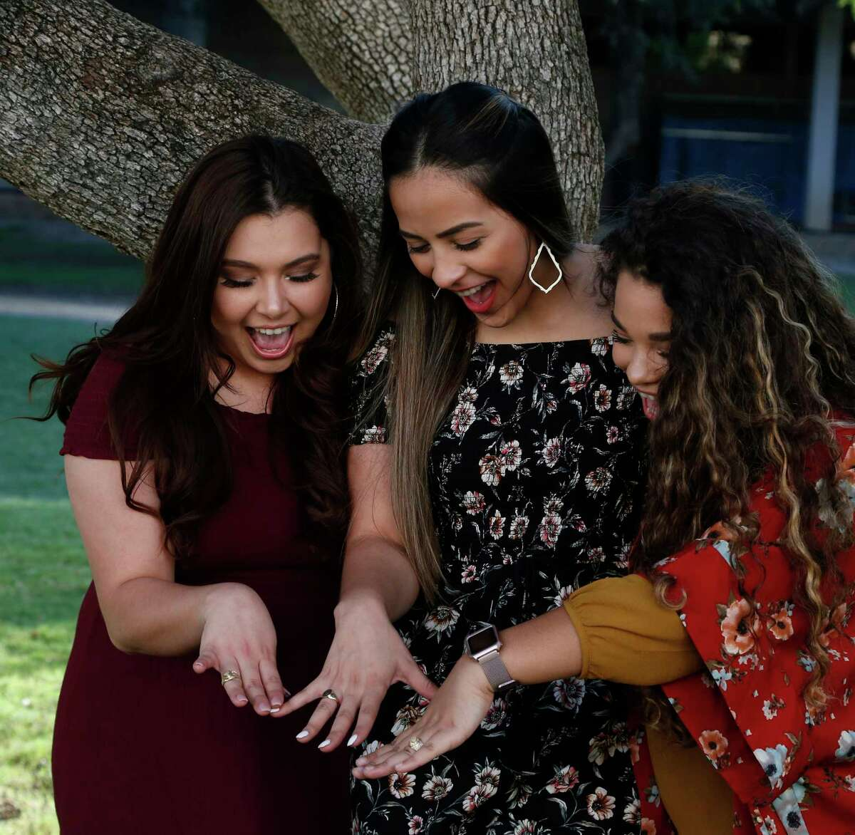 Jessica Brady, Alexis Gonzalez, and Dara Salazar admire their rings after the ceremony. Graduates are receiving their class rings this evening. This tradition is just six years old. UTSA Ring Ceremony Wednesday, May 9,2018 at H-E-B Student Union Ballroom,UTSA.