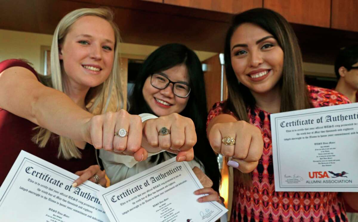 Brooke Allen,Thu Le, and Cindy Chavez show off their rings after the ceremony. Graduates are receiving their class rings this evening. This tradition is just six years old. UTSA Ring Ceremony Wednesday, May 9,2018 at H-E-B Student Union Ballroom,UTSA.