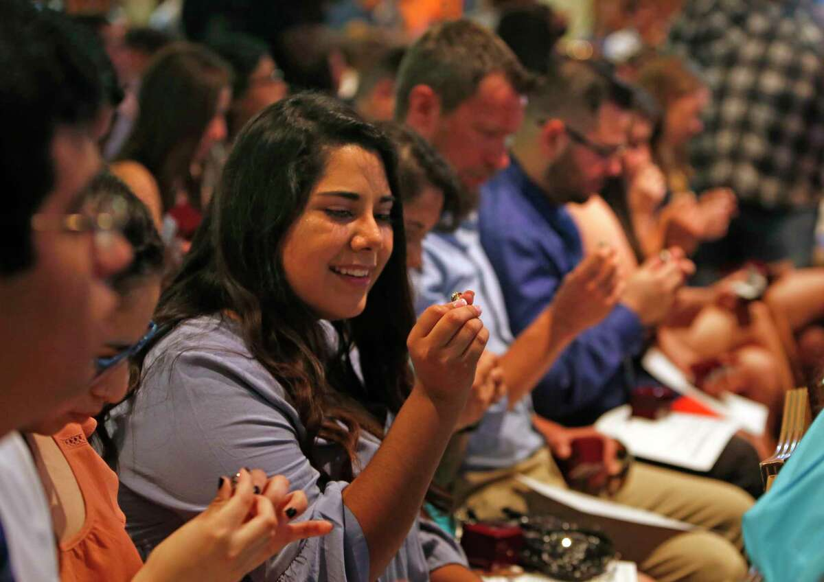 Adriana Medina admires her ring before she was to put it on her finger. Graduates are receiving their class rings this evening. This tradition is just six years old. UTSA Ring Ceremony Wednesday, May 9,2018 at H-E-B Student Union Ballroom,UTSA.