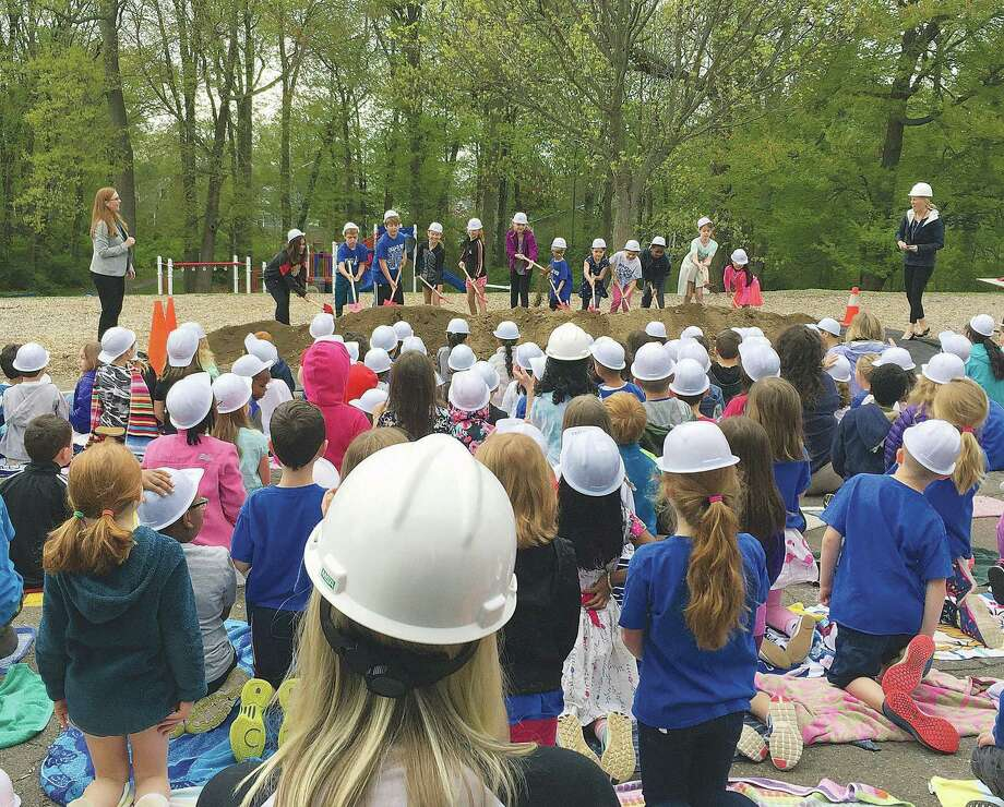 Students in hardhats look on as 12 of their classmates toss a cermonial shovel of dirt at the groundbreaking of Holland Hill Elementary School on Thursday, May 10, 2018. Photo: Jerrod Ferrari / Hearst Connecticut Media / Fairfield Citizen