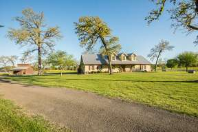 """Philanthropist Richard """"Dick"""" Wallrath's sprawling Champion Ranch in Centerville, Texas is currently for sale. It includes over 5,000 acres of ranchland, a 78-acre lake, and it even has its own saloon."""