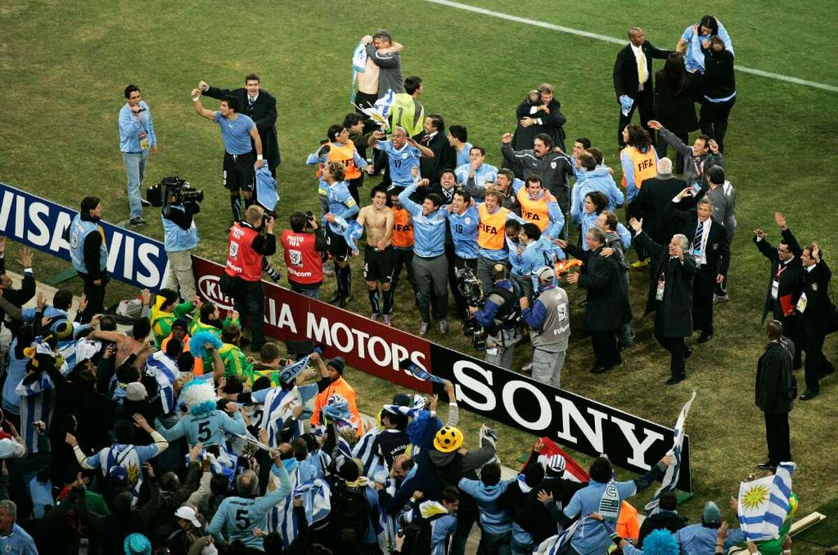 JOHANNESBURG, SOUTH AFRICA - JULY 02: Uruguay players celebrate victory after winning a penalty shoot out during the 2010 FIFA World Cup South Africa Quarter Final match between Uruguay and Ghana at the Soccer City stadium on July 2, 2010 in Johannesburg, South Africa. (Photo by Dominic Barnardt/Getty Images)