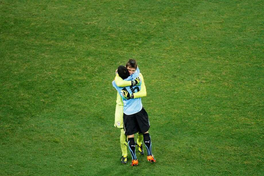 JOHANNESBURG, SOUTH AFRICA - JULY 02:  Fernando Muslera of Uruguay celebrates with Maximiliano Pereira after winning a penalty shoot out during the 2010 FIFA World Cup South Africa Quarter Final match between Uruguay and Ghana at the Soccer City stadium on July 2, 2010 in Johannesburg, South Africa.  (Photo by Dominic Barnardt/Getty Images) *** Local Caption *** Fernando Muslera Photo: Dominic Barnardt, Getty Images / 2010 Getty Images