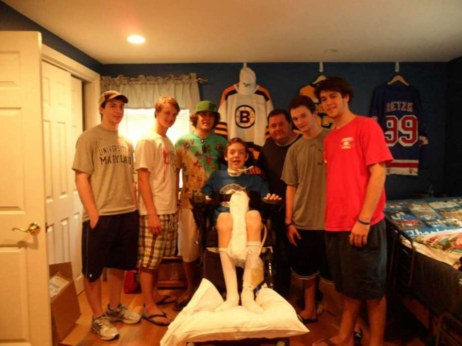Members of the Greenwich High hockey team visit with Matt Brown, a paralyzed 16-year old hockey player from Massachussetts. The Cardinals have raised over $27,000 for Brown and his family. From left to right, Adam Gelbs, Ricky Piper, Jonathan Darula, Matt Brown, Rich Spezzano, Rit Spezzano and Joey Lodato. Photo: Contributed Photo / Greenwich Time Contributed