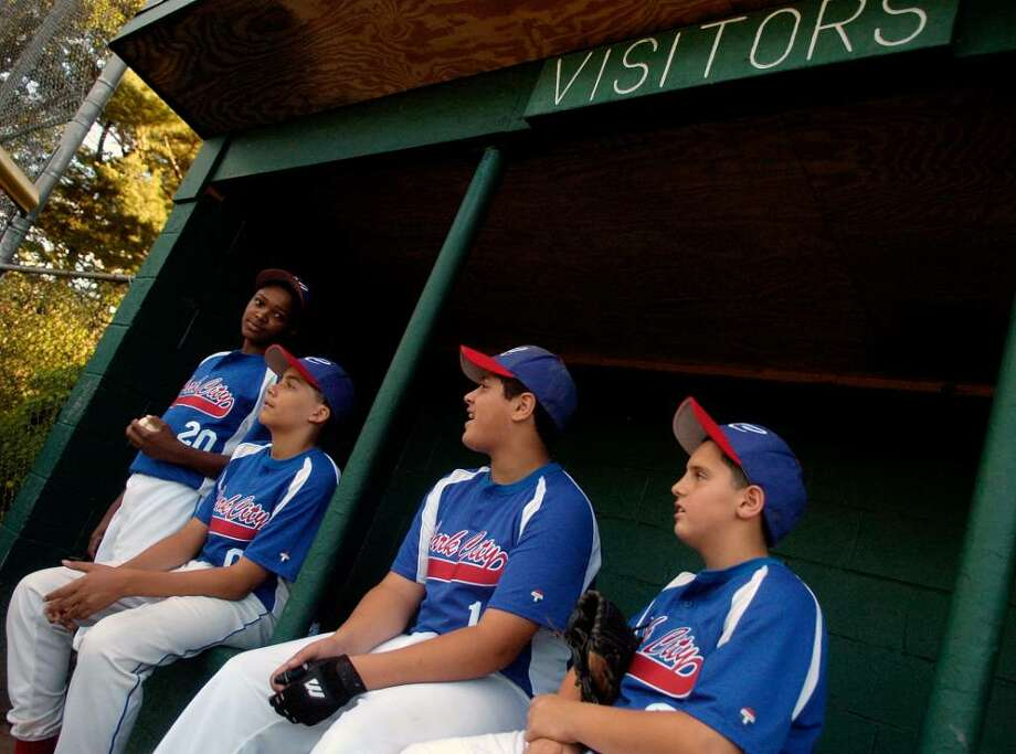 Park City of Bridgeport baseball players sit in the visitor's dugout during their game against Trumbull American at Blackham School on Friday, July 2, 2010. Photo: Lindsay Niegelberg / Connecticut Post
