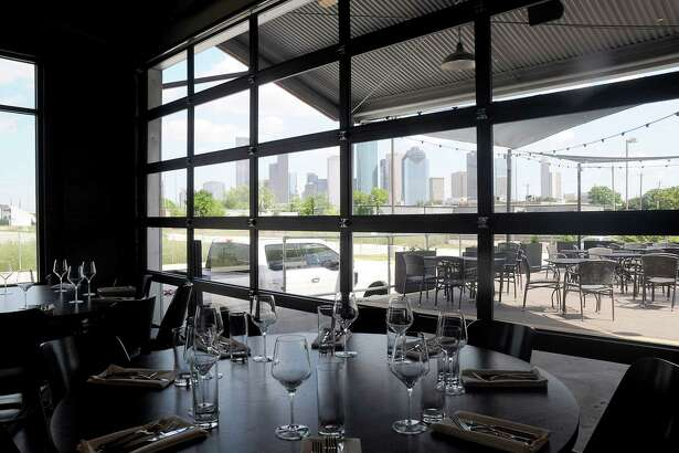 The view of downtown at Poitin restaurant at Sawyer Yards Wednesday May 9 ,2018.(Dave Rossman Photo)