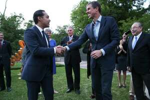 """Julián Castro and Beto O'Rourke exchange greetings April 14 in Austin. Castro and O'Rourke are being set up by the media as """"death match"""" competitors for the party's nomination."""