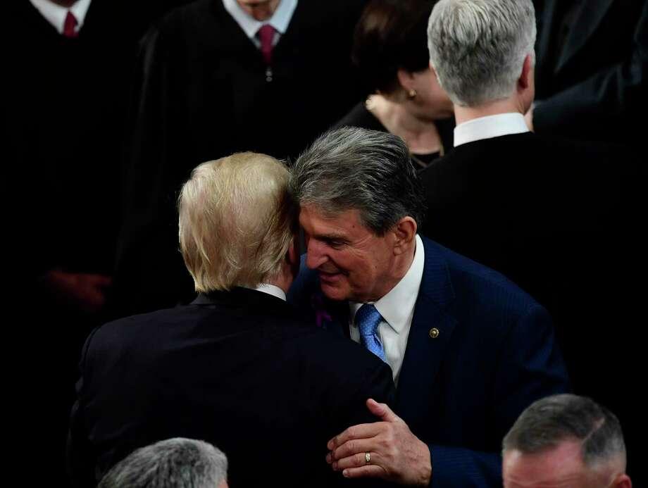 President Donald Trump greets Sen. Joe Manchin. Photo: Washington Post Photo By Melina Mara. / The Washington Post