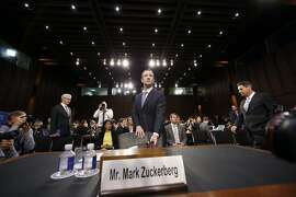 Facebook CEO Mark Zuckerberg arrives after a break to continue to testify before a joint hearing of the Commerce and Judiciary Committees on Capitol Hill in Washington, Tuesday, April 10, 2018, about the use of Facebook data to target American voters in the 2016 election. (AP Photo/Alex Brandon)