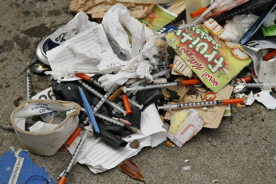 """File - In this Feb. 26, 2016, file photo, a number of syringes are scattered in the remains of a tent city being cleared by city workers along Division Street in San Francisco. The mayor of San Francisco says he is hiring 10 workers whose sole responsibility will be to clean up needles littering the streets. Mayor Mark Farrell said Monday, April 23, 2018, the team will respond to resident complaints and remove needles and syringes from """"hot spots"""" every day of the week. (AP Photo/Eric Risberg, File) Photo: Eric Risberg / Associated Press"""