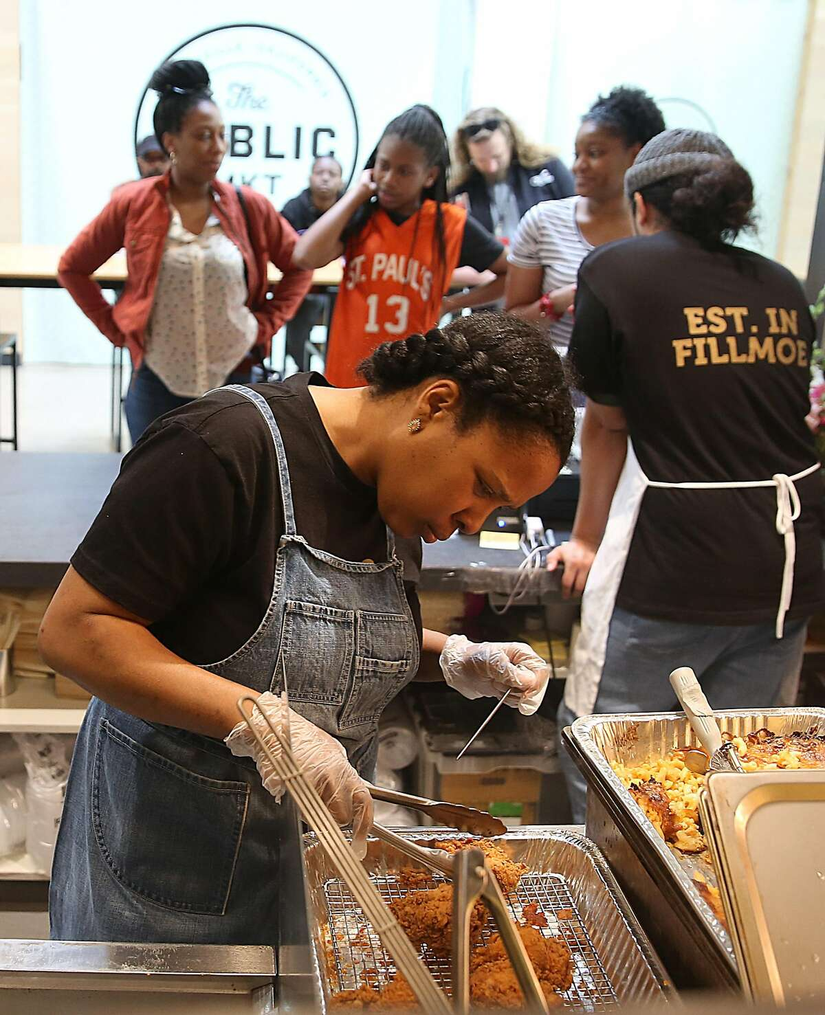 Owner Fernay McPherson takes temperature while frying her chicken at Minne Bell's Soul Movement in the Public Market on Monday, May 7, 2018 in Emeryville, Calif.
