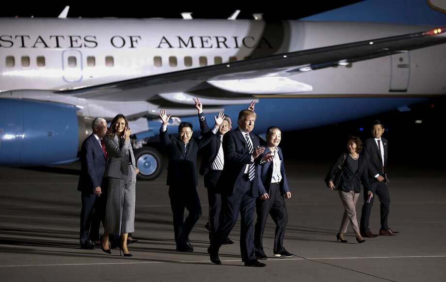 President Trump and first lady Melania Trump walk with three Korean-Americans held in North Korea at Andrews Air Force Base, Md. Photo: Alex Brandon / Associated Press