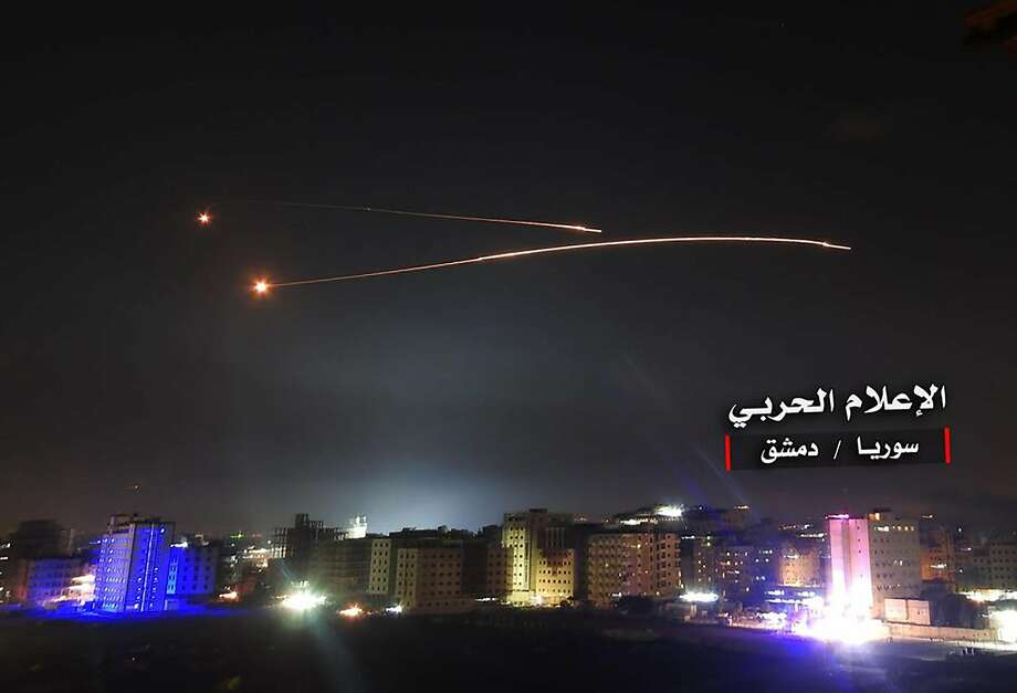 Syrian air defense systems intercept Israeli missiles over airspace of the capital, Damascus. Israel's army said it carried out widespread raids against Iranian targets inside Syria. Photo: AFP / Getty Images