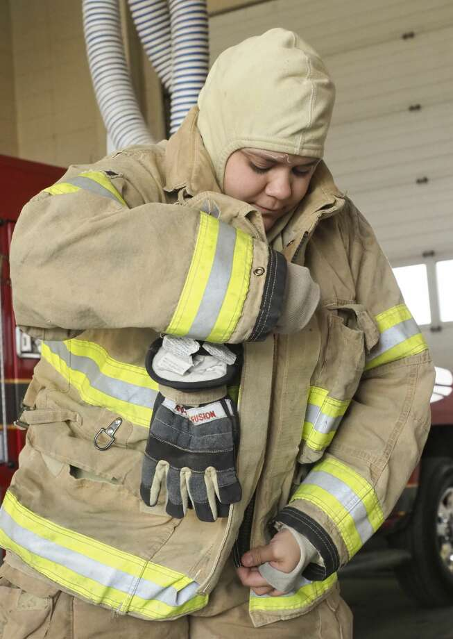 Firefighter Laura Ochoa suits out in her bunker gear March 26 at Midland Fire Department Station 3. Photo: Tim Fischer/Midland Reporter-Telegram
