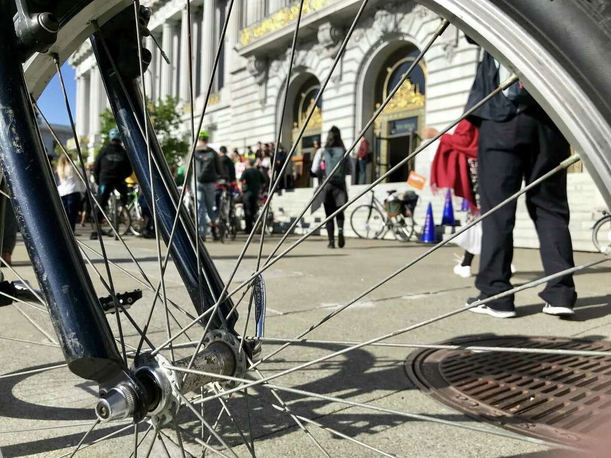 Bicyclists gather outside San Francsico City Hall on Bike to Work Day, May 10, 2018.