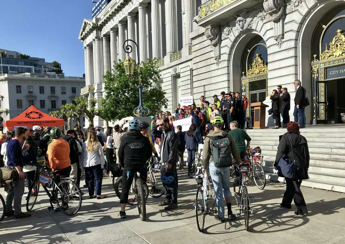 Bicyclists gather outside San Francisco City Hall on Bike to Work Day, May 10, 2018.