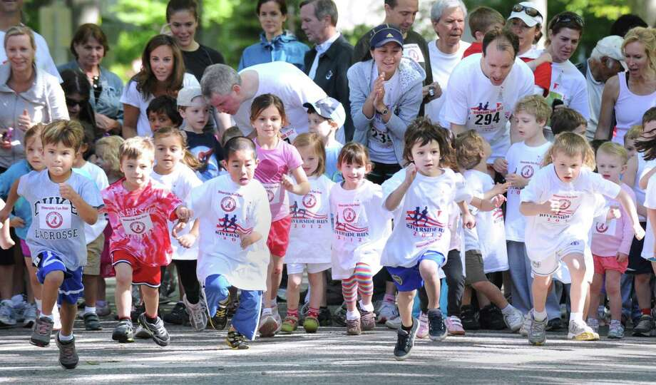 The start of the kids Fun Run during a previous Riverside Run, which is sponsored by the Riverside School PTA at Riverside School. The annual 3-mile scenic run/walk and Kids Fun Run will be this Saturday. Photo: Bob Luckey / Bob Luckey / Greenwich Time