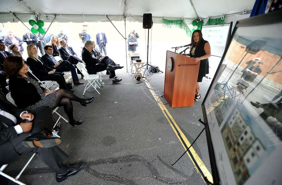 Bridgeport Neighborhood Trust CEO Elizabeth Torres addresses the groundbreaking ceremony for the Westgate Apartments in 2016. This week, BNT announced it was secured funding for another development in the neighborhood. Photo: Brian A. Pounds / Hearst Connecticut Media / Connecticut Post