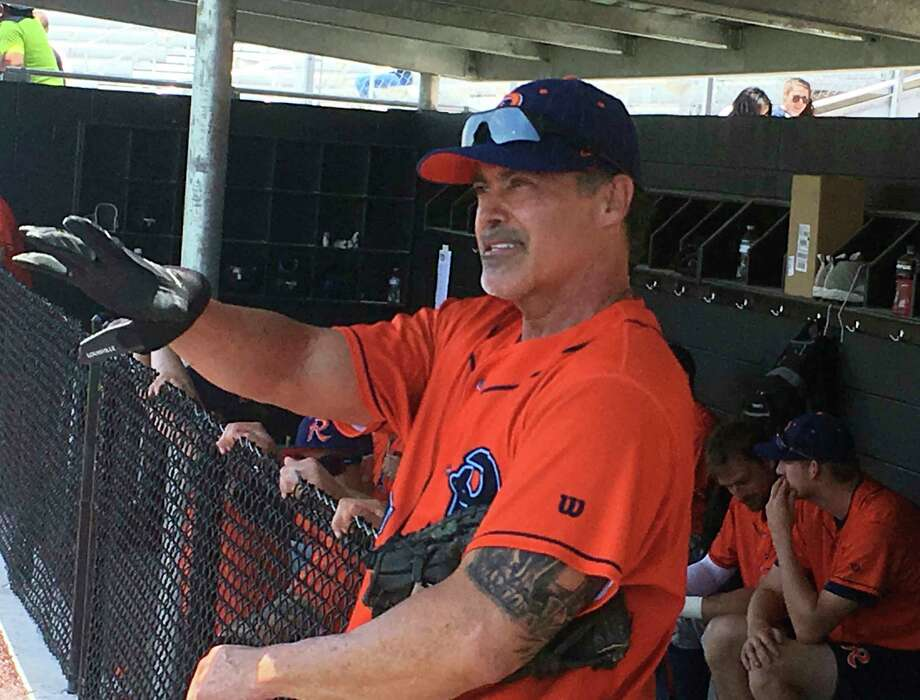 Cleburne Railroaders newly signed player and former Major League player, Rafael Palmeiro, talks with reporters from the dugout after a spring training baseball game in Cleburne, Texas, Thursday, May 10, 2018. The Railroaders also signed Palmeiro's son, Patrick to a deal. (AP Photo/Stephen Hawkins) Photo: Stephen Hawkins, Associated Press / Copyright 2018 The Associated Press. All rights reserved.