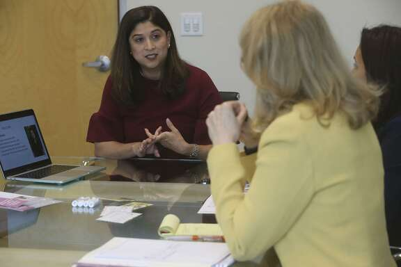 Esther Cardenas-Pipoly (left) consults Tuesday May 1, 2018 with Denise Strauss (center) and Priscilla Pike (right) about death planning at the Crowsley Law Firm. Pipoly helps people plan and deal with complicated matters when a loved one dies. She started LOLA (Loss of Life Advocates) after losing her father and husband within a short period of time.