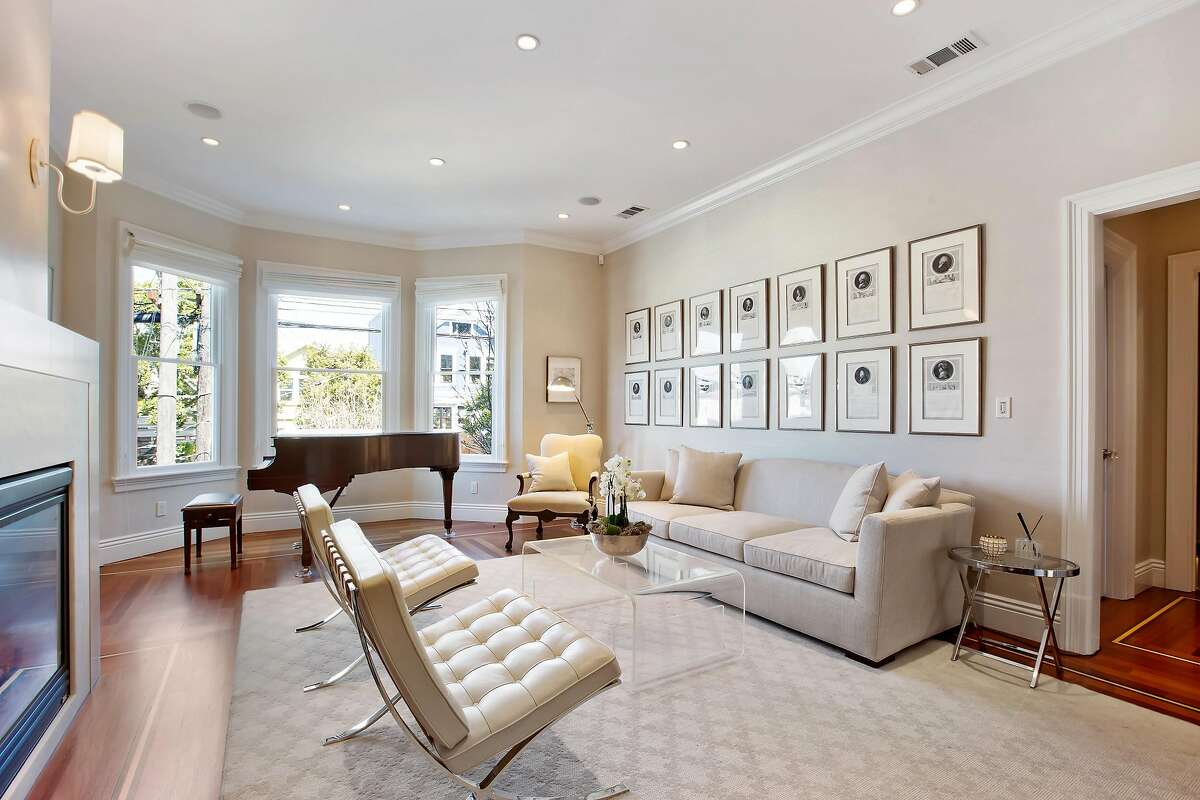 Bay windows, wide moldings and a gas fireplace accent the living room.