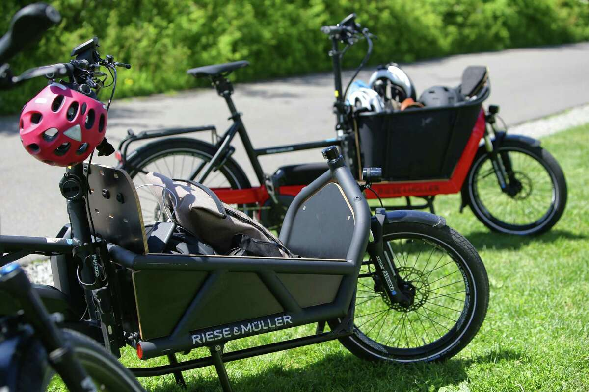 Riese & Muller's ebikes, the Lode (foreground) and Packster 40 have boxes for holding kids or other cargo.