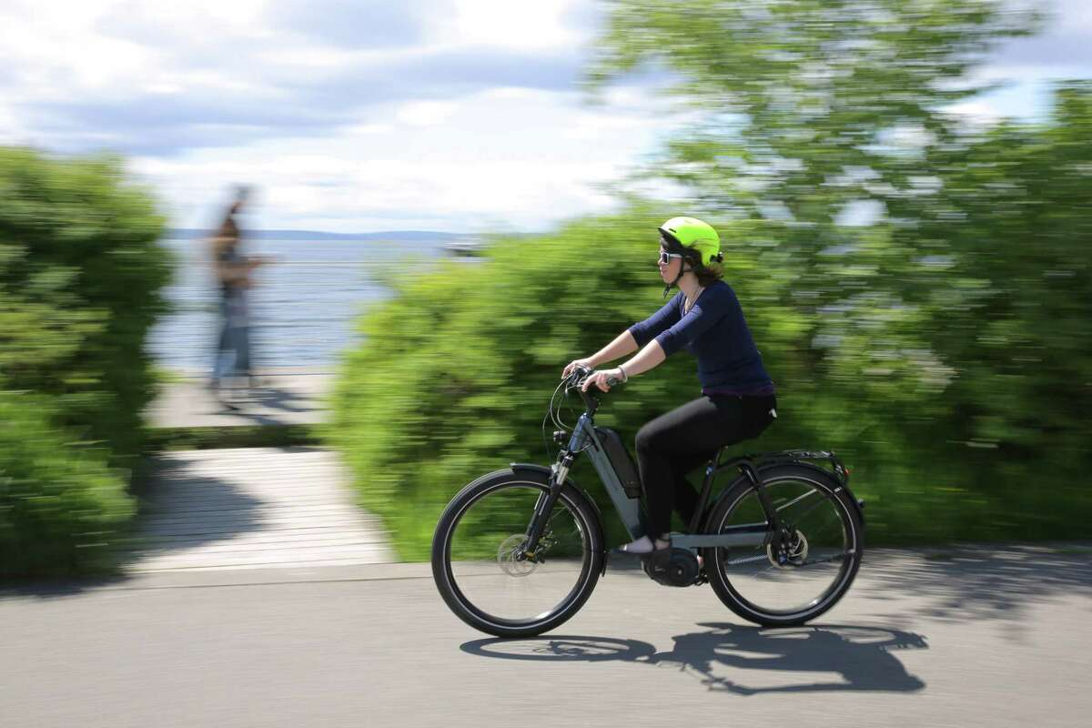 Zosha Millman rides Riese & Muller's Nevo ebike at Olympic Sculpture Park.
