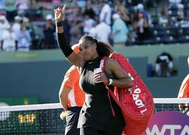 "FILE - In this March 21, 2018, file photo, Serena Williams walks off the court after losing to Naomi Osaka at the Miami Open tennis tournament in Key Biscayne, Fla.  Serena Williams has withdrawn from next week's Italian Open, saying she needs more time to be ""100 percent ready to compete."" The tournament made the announcement via Twitter.  (AP Photo/Lynne Sladky, File)"