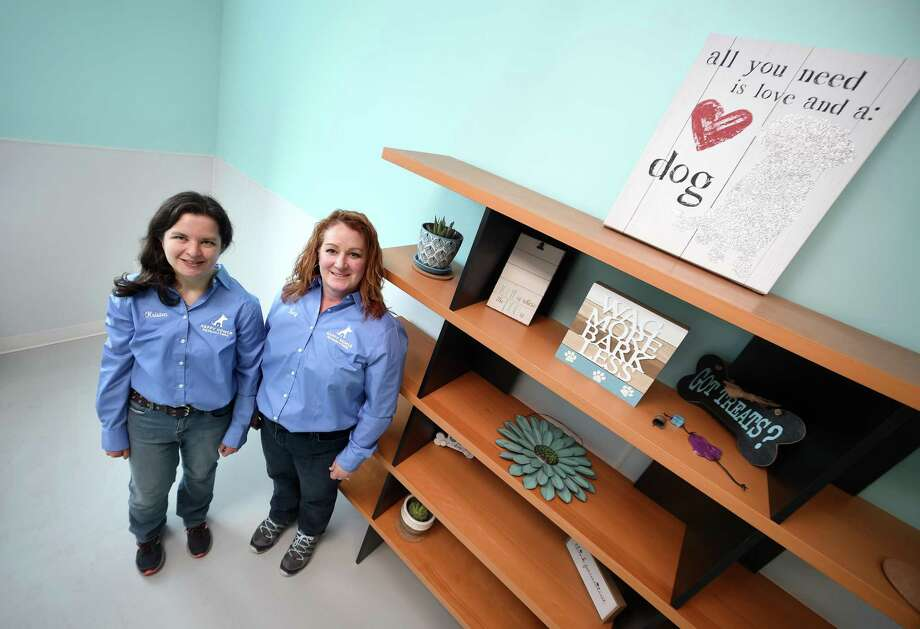 Kristen Iannucci, left, and Dr. Tracy Johnson, co-owners of Happy Homes Dog Daycare & Training,  in the new facility in Woodbridge. Photo: Arnold Gold / Hearst Connecticut Media / New Haven Register