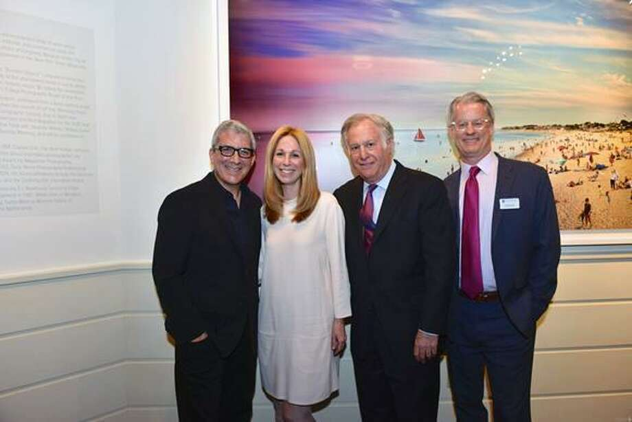 """Jennings Beach, Fairfield, Day to Night"" was unveiled at the Fairfield Museum's gala preview party on April 28. More than 200 people attended the event, which was chaired by Fairfield residents Jen Hinkle and Sylvia Neigher, and raised funds to support the museum's education programs. From left are photographer Stephen Wilkes, Bette Wilkes, Stephen Saft and Michael Jehle, executive director of the Fairfield Museum. Photo: Marilyn Roos / Contributed Photo"