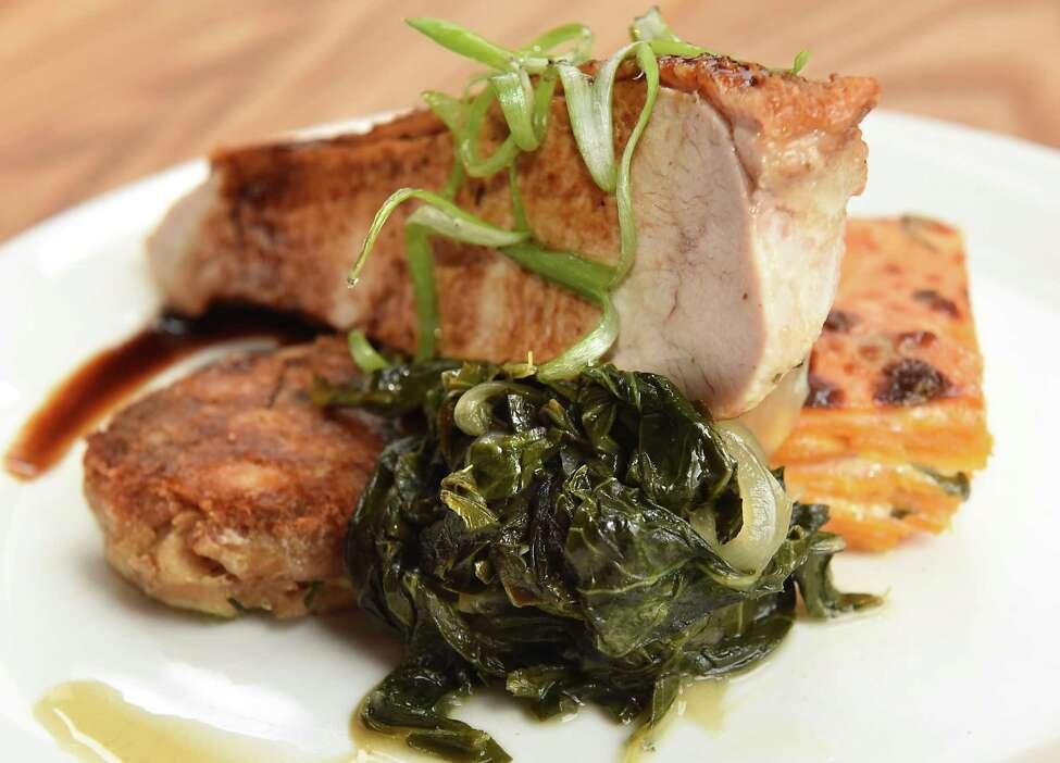 Buckley Farm chicken, confit leg, cider collards, sweet potato gratin, peppercorn demi at Malcolm's restaurant on Union St. on Wednesday April 25, 2018 in Schenectady, N.Y. (Lori Van Buren/Times Union)