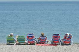 Compo Beach was busy on May as people got outside to enjoy the warm weather