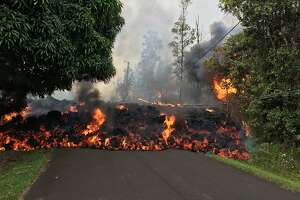 "TOPSHOT - This image obtained May 9, 2018, released by the US Geological Survey shows a lava flow moving on Makamae Street in Leilani Estates at 09:32 am local time, on May 6, 2018 in Leilani Estates, Hawaii. The Kilauea Volcano, the most active in Hawaii, was highly unstable on May 6, 2018, as lava spouted into the air and fissures emitted deadly gases -- hazards that have forced thousands of people to evacuate. / AFP PHOTO / US Geological Survey / HO / RESTRICTED TO EDITORIAL USE - MANDATORY CREDIT ""AFP PHOTO / US Geological Survey/HO"" - NO MARKETING NO ADVERTISING CAMPAIGNS - DISTRIBUTED AS A SERVICE TO CLIENTS  HO/AFP/Getty Images"
