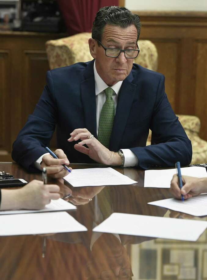 Connecticut Gov. Dannel P. Malloy works on his final closing speech at the end of session in his office the at the State Capitol, Wednesday, May 9, 2018, in Hartford, Conn. (AP Photo/Jessica Hill) Photo: Jessica Hill / Associated Press / AP2018