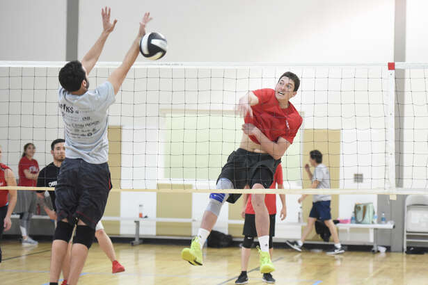 Andrew Bastien plays volleyball at the YMCA on March 27.