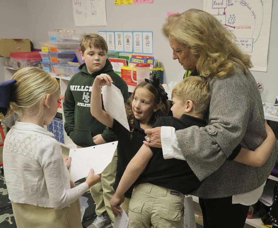 Betty Starnes, executive director of Hillcrest School, interacts with students on April 5. Photo: Tim Fischer/Midland Reporter-Telegram