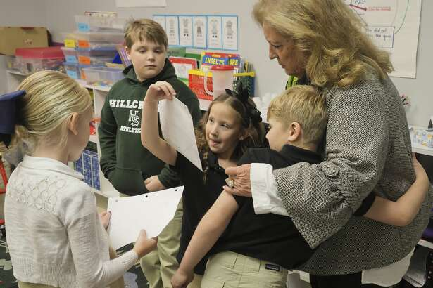 Betty Starnes, executive director of Hillcrest School, interacts with students on April 5.