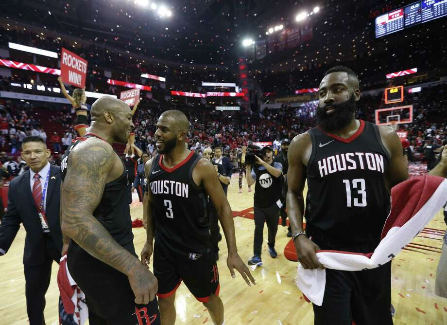 Houston Rockets guards Chris Paul (3) and forward PJ Tucker (4) along with James Harden (13) celebrate the Rockets win over Utah Jazz during the second half in Game 5 of an NBA basketball second-round playoff series at Toyota Center, Tuesday, May 8, 2018, in Houston. ( Brett Coomer / Houston Chronicle ) Photo: Brett Coomer, Staff / Houston Chronicle / © 2018 Houston Chronicle