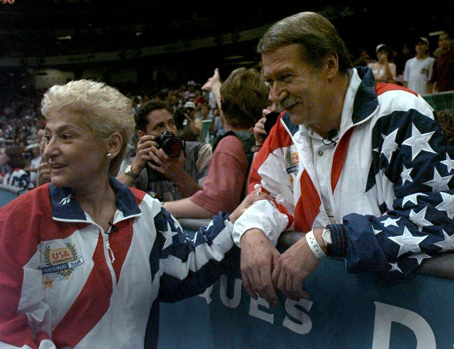 FILE - In this July 23, 2004, file photo, Martha and Bela Karolyi watch together as the U.S. womens gymnastic team celebrates winning the gold medal at the Centennial Summer Olympic Games in Atlanta. Victims of disgraced sports doctor Larry Nassar are imploring Texas authorities to investigate whether Bela and Martha Karolyi could have done more to prevent Nassar's sexual abuse at the couple's Texas training center. Five former gymnasts, including two who say Nassar abused them at the Karolyis' ranch near Huntsville, addressed reporters Thursday, May 10, 2018, outside state Attorney General Ken Paxton's office. (AP Photo/Amy Sancetta, File) Photo: AMY SANCETTA, STF / Associated Press / AP2004