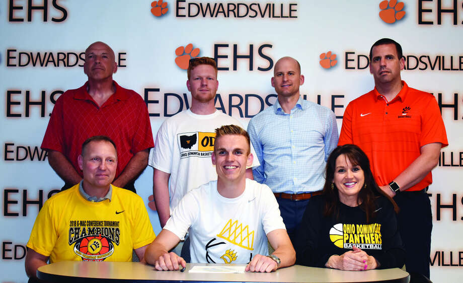 EHS senior Caleb Strohmeier, seated center, will play men's basketball for Ohio Dominican. Seated from left to right are Rodney Strohmeier, father, Caleb Strohmeier and Lori Reeter, mother. Standing from left to right are EHS coach Mike Waldo, Cole Strohmeier, brother, and EHS coaches Dustin Battas and Kyle Stewart.
