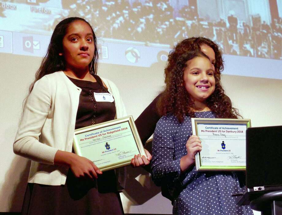 Hersha Chauhan, 13, left, was named Ms President of Ridgefield and Brianna Razeq, 11, was named Ms President of Danbury at an election held by Ridgefield nonprofit Ms President US, which teaches girls fourth through eighth grade about civic engagement and leadership skills. Photo: Karen Hwang / Hearst Connecticut Media / The News-Times Contributed