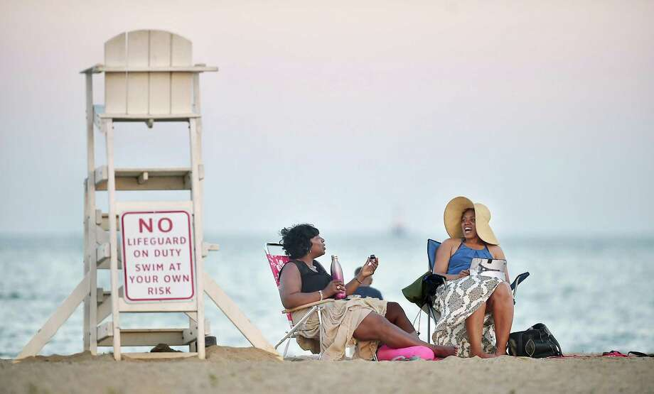 New Haven residents Leslie William, left, and Bobbi Lawrence chat at Sandy Point Beach on Beach Street in West Haven in this 2017 file photo. Photo: Catherine Avalone / Hearst Connecticut Media / Catherine Avalone/New Haven Register