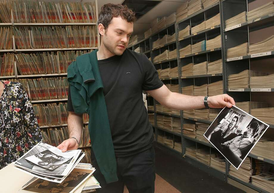 Arlen Ehrenreich checks out photos of George Lucas in the Chronicle archives before doing a podcast. Photo: Liz Hafalia, The Chronicle