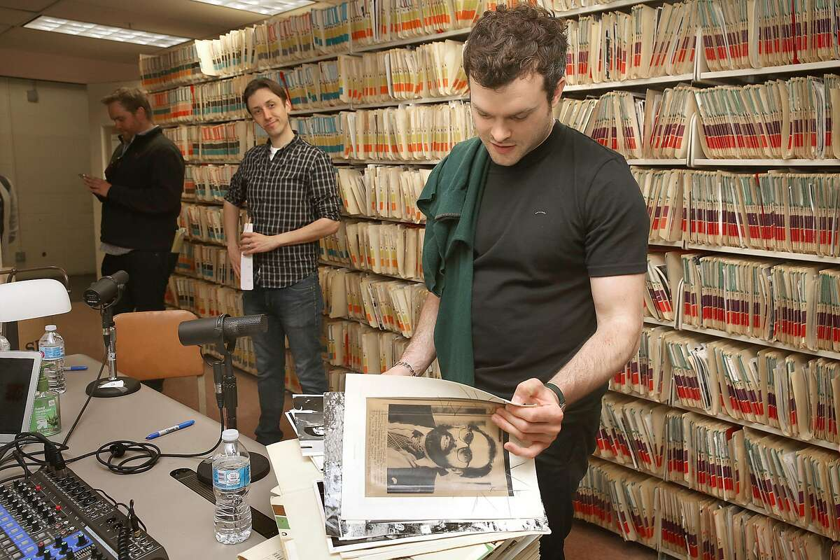 Arlen Ehrenreich checks out photos of George Lucas in the Chronicle archives before doing a podcast.