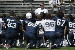 Coach Randy Edsall talks with his team at the end of UConn's annual spring game this past April.