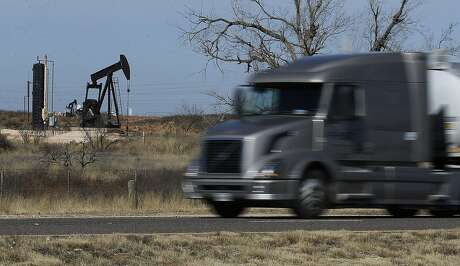 A commercial truck zooms past a pump jack near Andrews, Texas. According to the town's business leadership, Andrews' main revenue generator is oil and oil field services. Waste Control Specialists (WCS) near Andrews, Texas provides services to store low-level nuclear waste and is in the process of applying for a license to be an interim storage facility for high-level radioactive waste. Opposition has mostly stemmed from activists outside the area but some residents are also voicing concerns about their city becoming the nation's dump site for potentially hazardous nuclear material. The Governmental Nuclear Regulatory Commission (NRC) has held hearings regarding the potential environmental impact of permitting WCS in far West Texas and activists along with proponents have been vocal in those hearings. (Kin Man Hui/San Antonio Express-News)