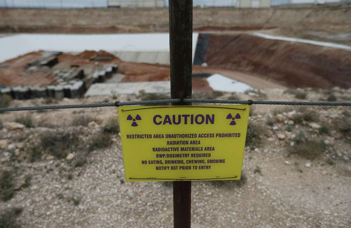 A caution sign surrounding the low-level radioactive waste site at Waste Control Specialists near Andrews, Texas. After hearing from Andrews County residents in packed meetings Thursday and on July 6, commissioners voted unanimously to sign a resolution stating their opposition to the storage of high-level nuclear waste in the county.