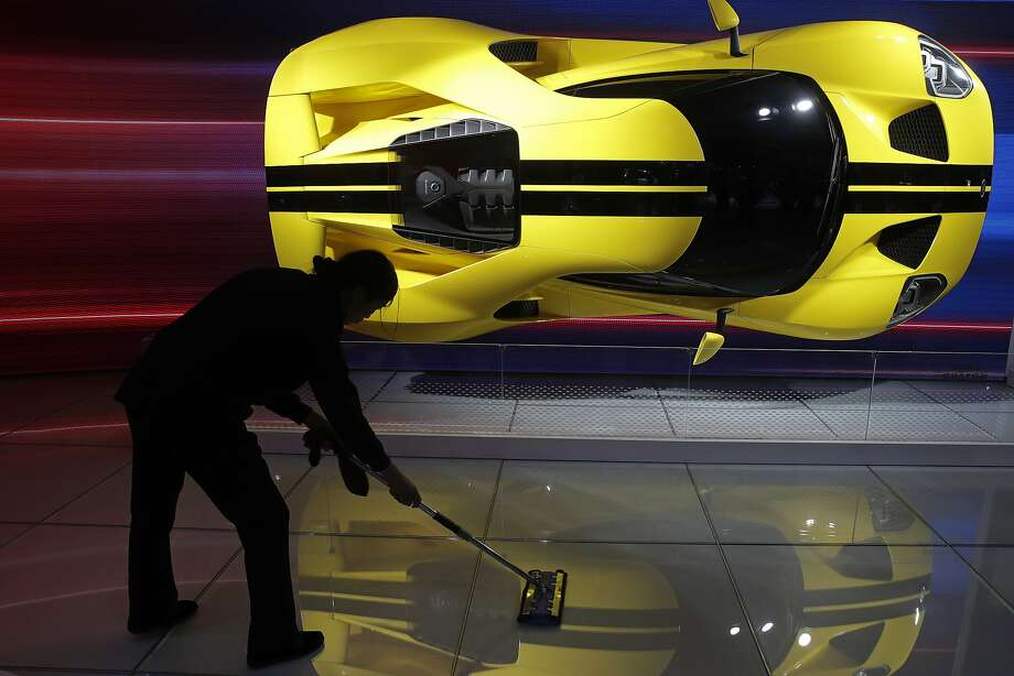 A worker wipes near a Ford GT sports car on display at the China Auto Show during the media day in Beijing late last month. Photo: Andy Wong / Associated Press